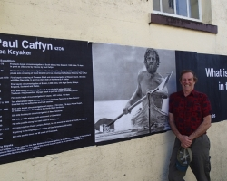 Paul posing under Greymouth NZ poster Famous People from our Community Oct 2014