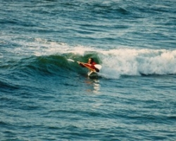 Paul waveskiing in front of his home at 12 Mile NZ